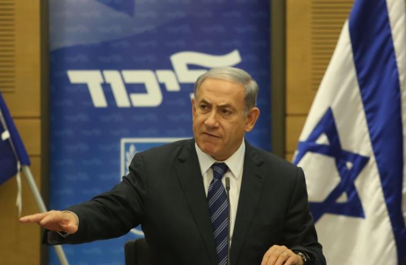 Prime Minister Benjamin Netanyahu gestures during an appearance at a Likud faction meeting (photo credit: MARC ISRAEL SELLEM)