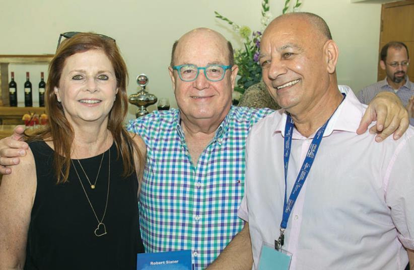 FROM LEFT, Dalia Rabin, Tuvia Tsafir and Moshe Alon at launch for the late Robert Slater's updated book on Yitzhak Rabin. (photo credit: Courtesy)