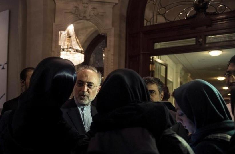 Head of the Iranian Atomic Energy Organization Ali Akbar Salehi speaks with reporters [File] (photo credit: REUTERS)