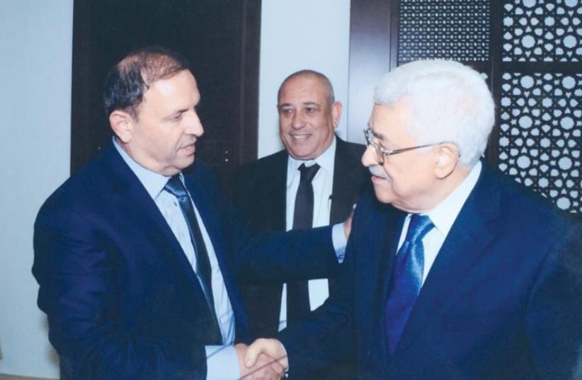 ZIDAN KAABIYA, head of Forum of Northern Beduin Council, meets with PA President Mahmoud Abbas in Ramallah on Saturday. (photo credit: Courtesy)