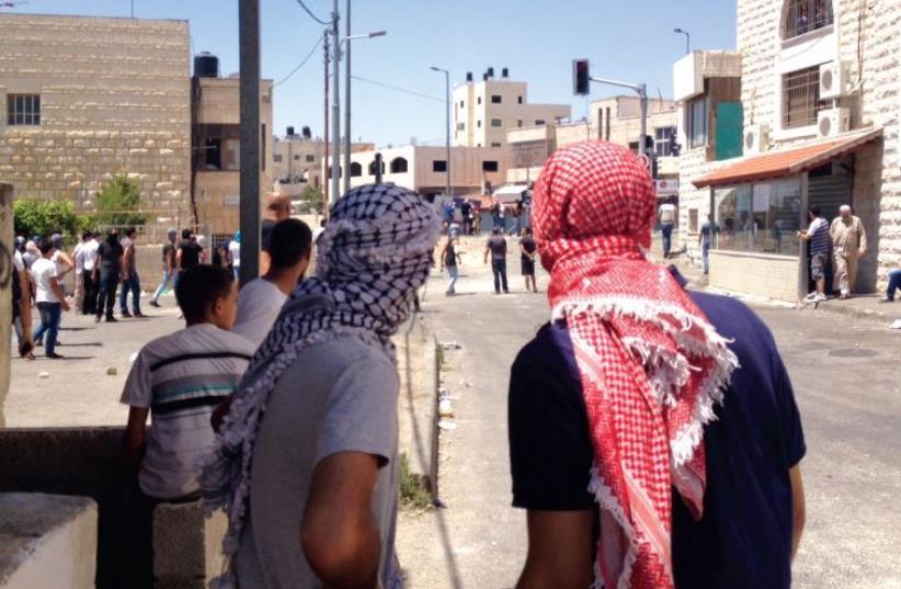 Rock-throwing in east Jerusalem in July 2014. (photo credit: SETH J. FRANTZMAN)