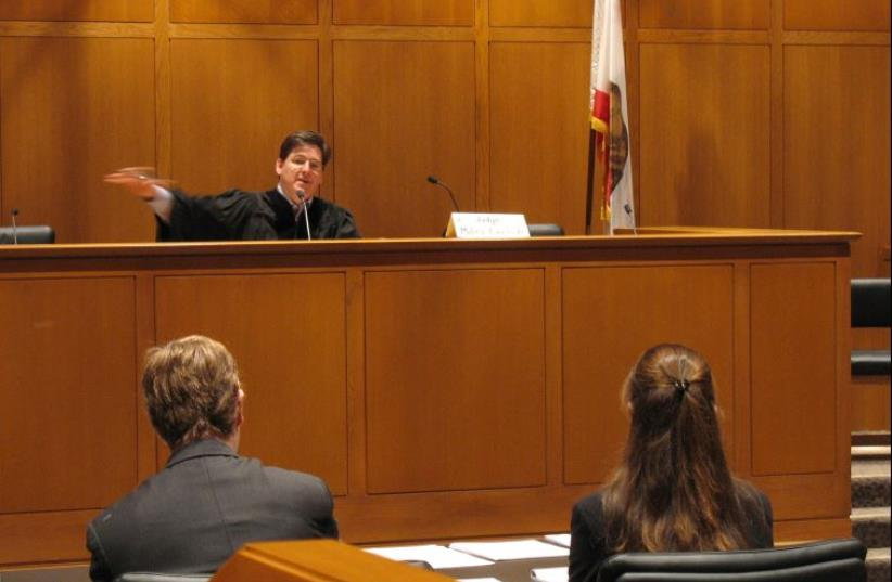 A judge in a courtroom hearing (photo credit: WIKIMEDIA COMMONS/FLICKR)