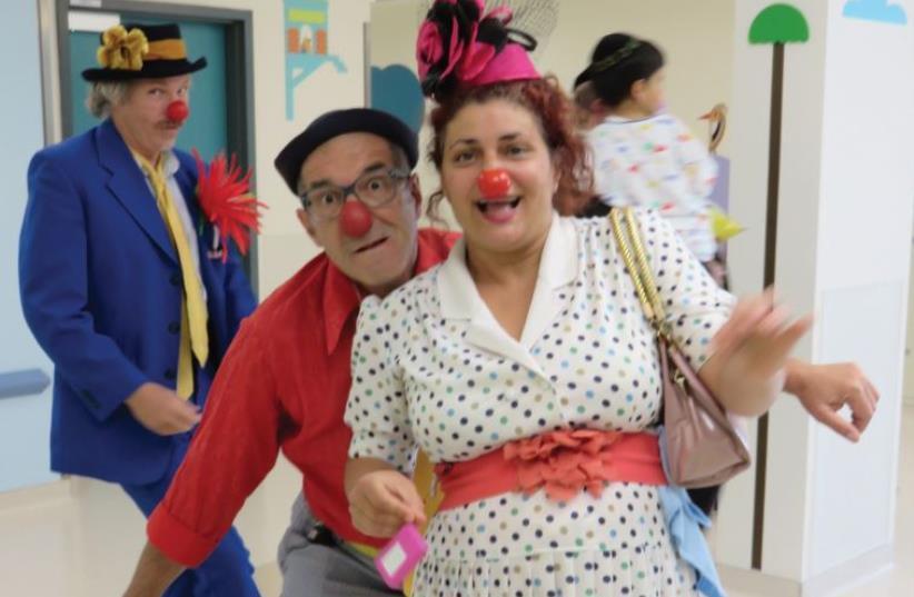 Medical Clowns at work.  (photo credit: JUDY SIEGEL-ITZKOVICH)