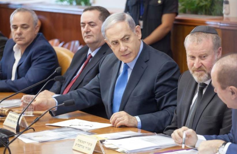 Netanyahu at cabinet meeting (photo credit: EMIL SALMAN/POOL)