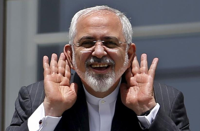 Iranian Foreign Minister Mohammad Javad Zarif gestures as he talks with journalist from a balcony of the Palais Coburg hotel where the Iran nuclear talks meetings are being held in Vienna, Austria (photo credit: REUTERS)