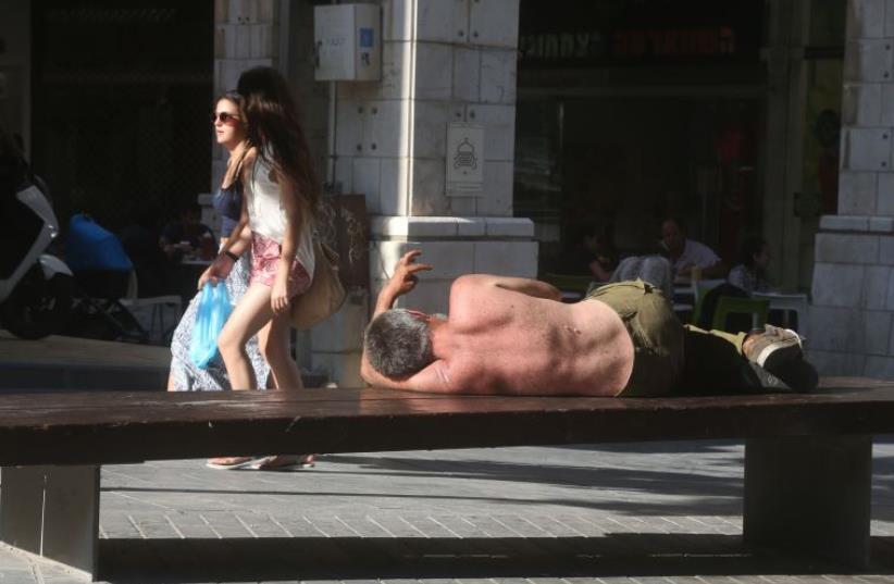 Beggar in Jerusalem (photo credit: MARC ISRAEL SELLEM/THE JERUSALEM POST)