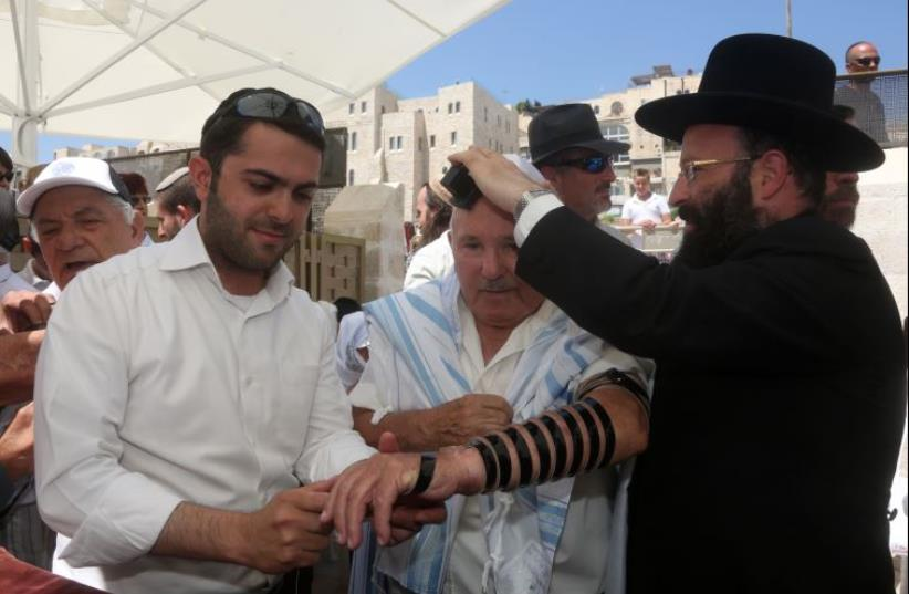 Late Bar-Mitzva for Holocaust survivors at the Western Wall (photo credit: MARC ISRAEL SELLEM/THE JERUSALEM POST)