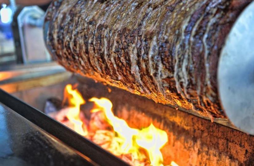 Shawarma roasting over coals at Bandura in Bnei Brak (photo credit: ELAD GUTMAN)