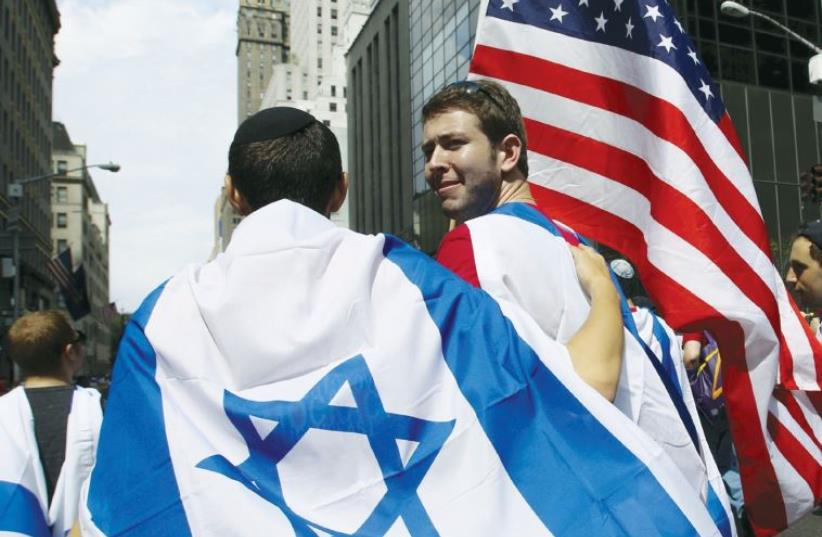 People take part in the 51st annual Israel parade in New York in May. (photo credit: EDUARDO MUNOZ / REUTERS)