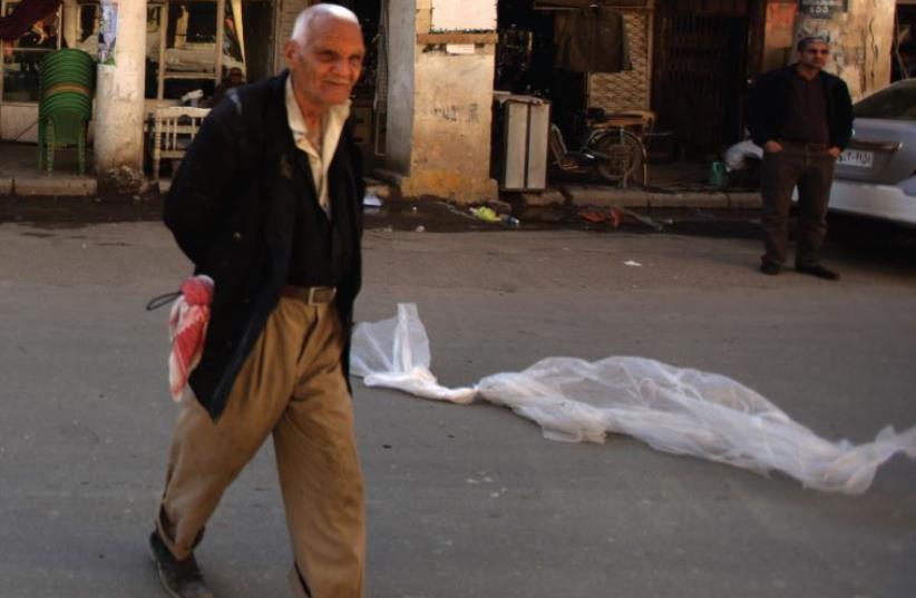 Ramshackle al-Rasheed Street, in the heart of old Baghdad. (photo credit: PATRICK BAZ / AFP)