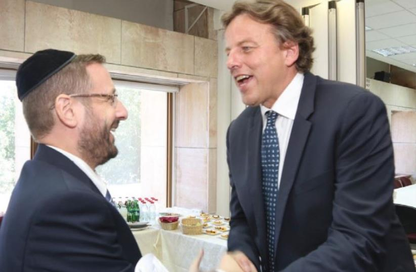 Dov Lipman and Dutch Foreign Minister Bert Koenders (photo credit: SASSON TIRAM)