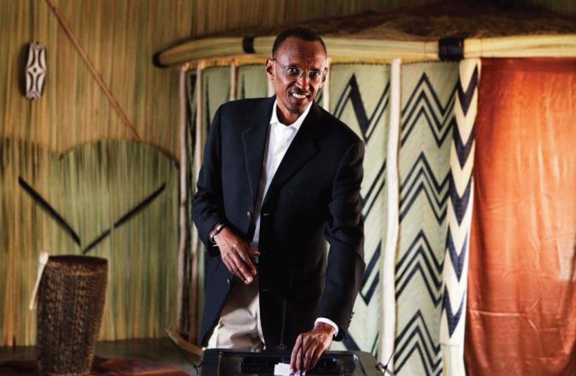 RWANDAN PRESIDENT Paul Kagame casts his ballot during the presidential election in Kigali in 2010 (photo credit: REUTERS)