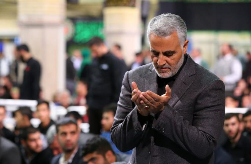 commander of the Iranian Revolutionary Guard's Quds Force, Gen. Qassem Suleimani, attending a religious ceremony in Tehran to commemorate the anniversary of the death of Fatima, the daughter of Prophet Mohammed. (photo credit: AFP PHOTO)