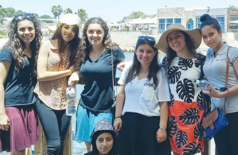 A group of teenage girls, in which half are American Jews and half are Israeli- Arabs from the Galilee, gather for a picture in Caesarea two weeks ago.  (photo credit: Courtesy)