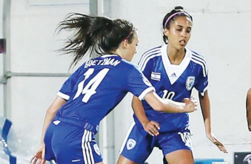 Striker Eden Avital (right) scored Israel's first goal of the Women's Under-19 European Championship last night, but midfielder Lauren Goetzman (center) and the blue-and-white couldn't maintain the lead, dropping to a 2-1 defeat to Denmark in Lod (photo credit: ISRAEL FOOTBALL ASSOCIATION WEBSITE)