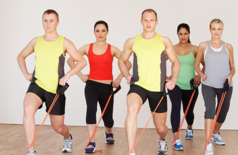 Group exercise at a gym [Illustrative] (photo credit: INGIMAGE)