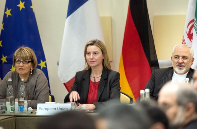 EU Political Director Helga Schmid (L), EU High Representative Federica Mogherini (C) and Iranian Foreign Minister Javad Zarif at nuclear talks in Lausanne March 31, 2015 (photo credit: REUTERS)