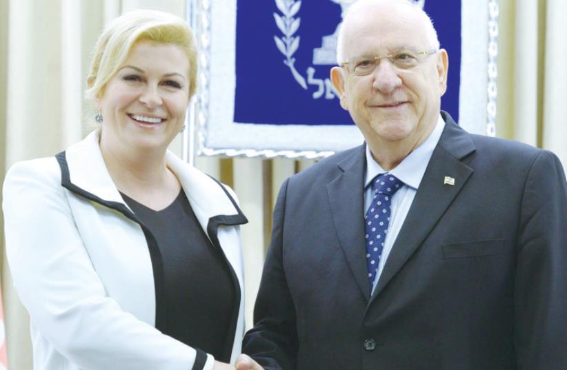 Croatian President Kolinda Grabar-Kitarovic meets with President Reuven Rivlin at his residence yesterday (photo credit: MARK NEYMAN / GPO)