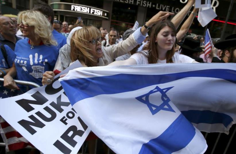 Protestors shout slogans as they demonstrate with thousands of others during a rally apposing the nuclear deal with Iran in New York (photo credit: REUTERS)