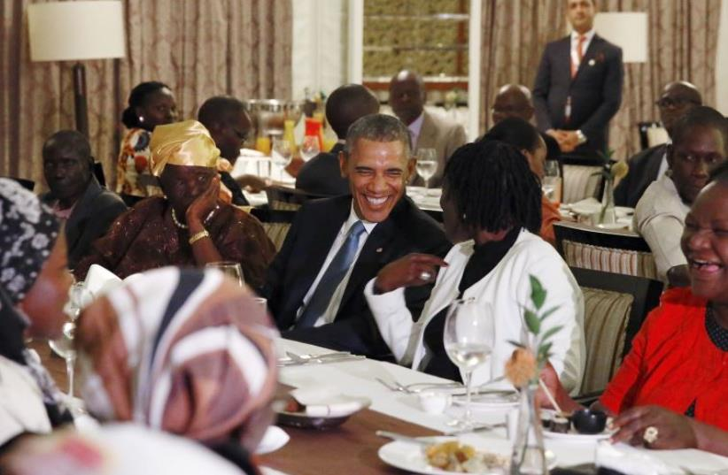 Obama attends private dinner with family members at his hotel restaurant after arriving in Nairobi July 24, 2015. (photo credit: REUTERS)