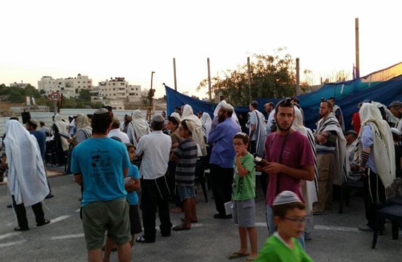 Sunday night prayer service to protest pending demolition of 24 apartment units in Beit El, July 26, 2015 (photo credit: COURTESY OF THE BEIT EL COUNCIL)