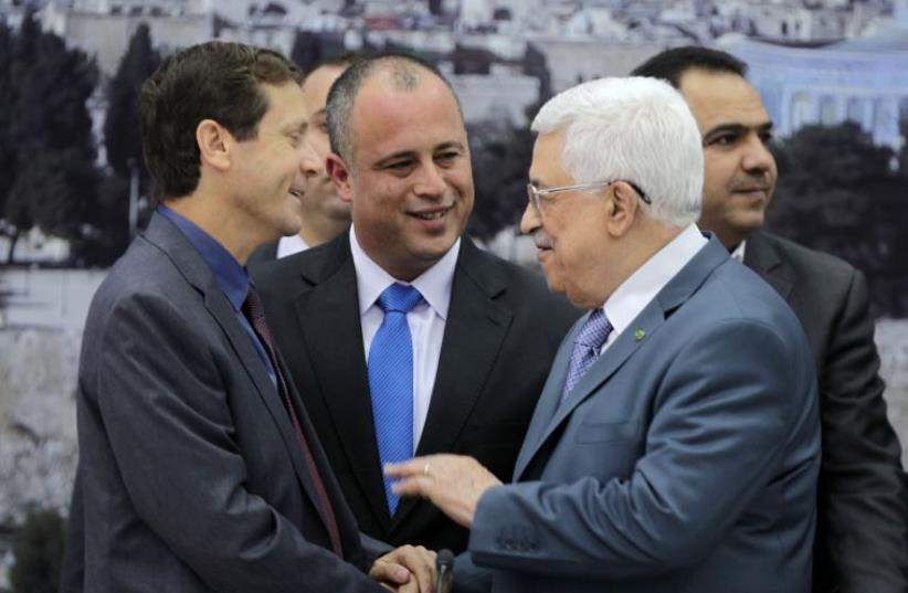 Zionist Union MKs Isaac Herzog (L) and Hilik Bar (C) shake hands with Palestinian President Mahmoud Abbas as they attend a meeting in Ramallah (photo credit: REUTERS)