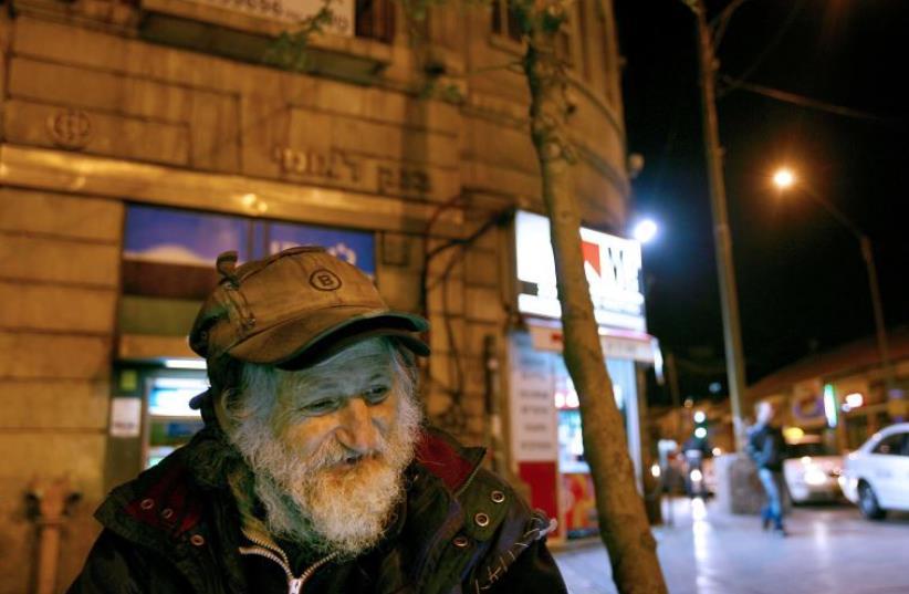 Dov, a homeless Israeli man, stands in Jerusalem (photo credit: REUTERS)
