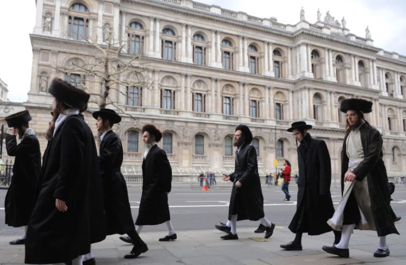 Orthodox Jews walk along Whitehall in central London (photo credit: REUTERS)