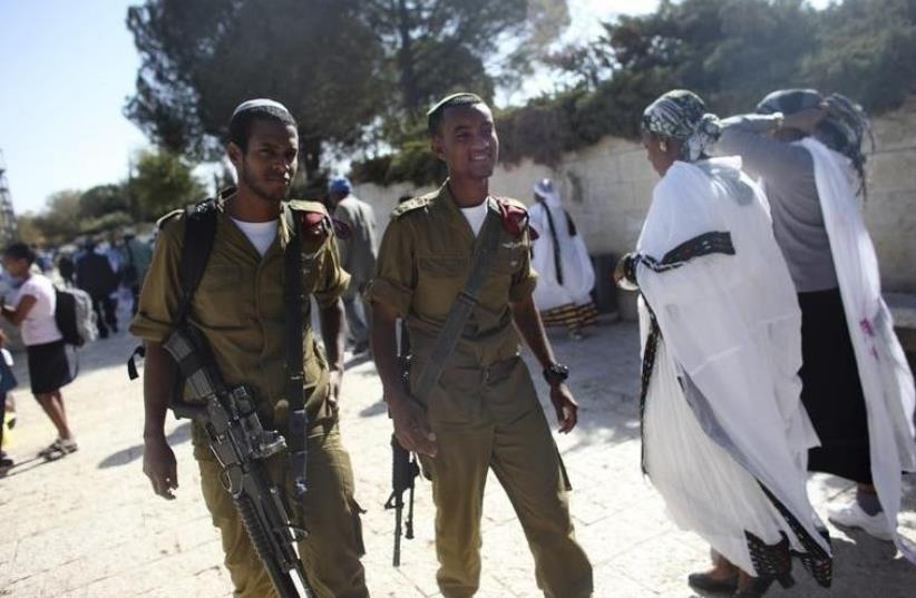 IDF soldiers take part in a ceremony marking the Ethiopian Jewish holiday of Sigd  (photo credit: REUTERS)