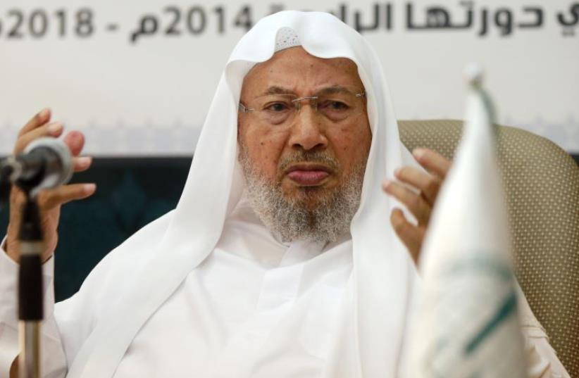 Chairman of the International Union of Muslim Scholars Youssef al-Qaradawi speaks during a news conference in Doha (photo credit: REUTERS)