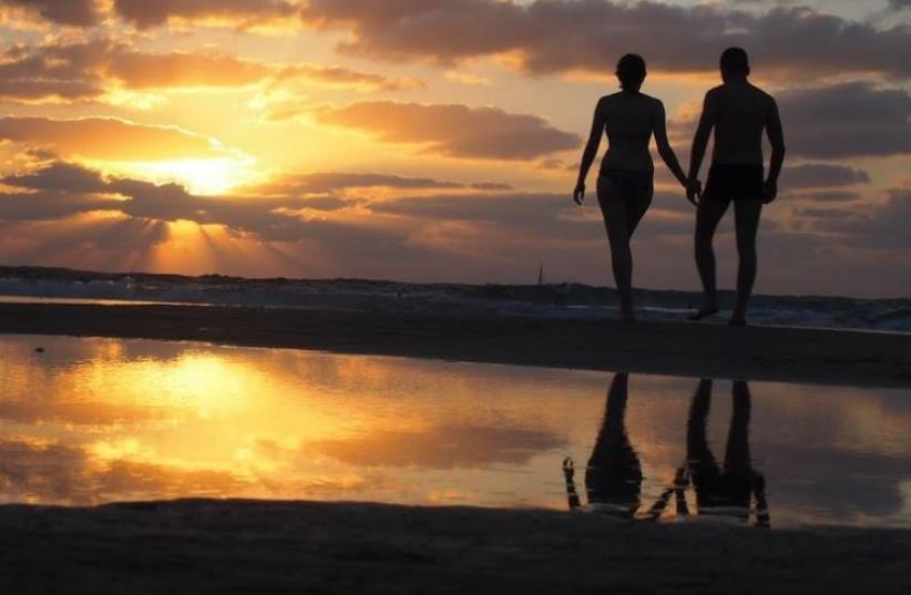 Couple on the beach in Herzliya (photo credit: NORA MIHAYLOVA)