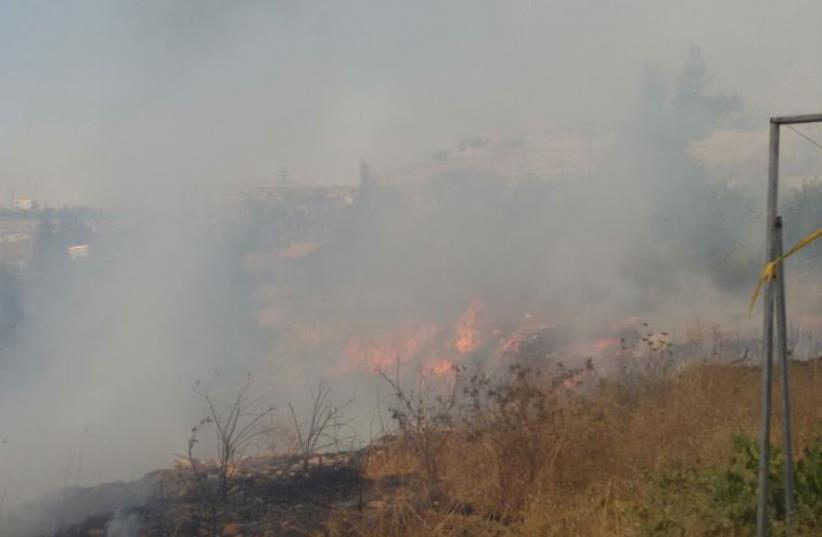 A fire believed to have been caused by Palestinian arsonists near a settlement (photo credit: MAARIV)