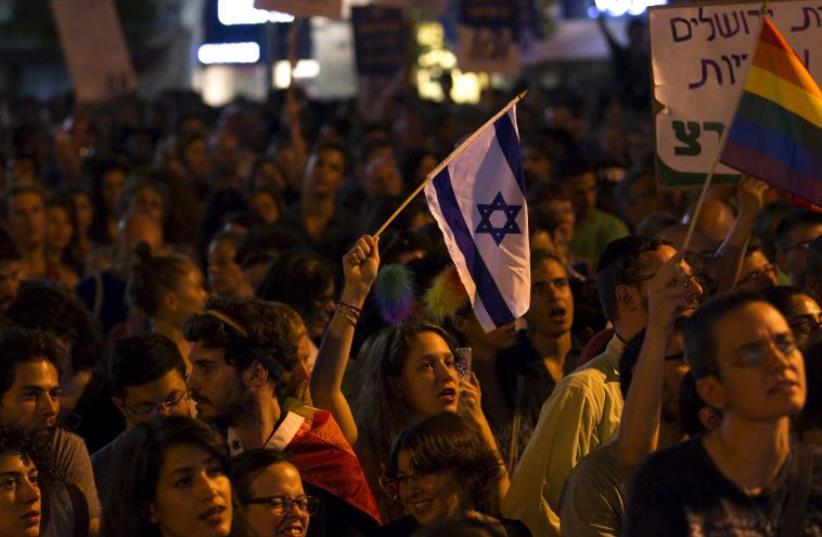 Anti violence rally in Tel Aviv (photo credit: REUTERS)