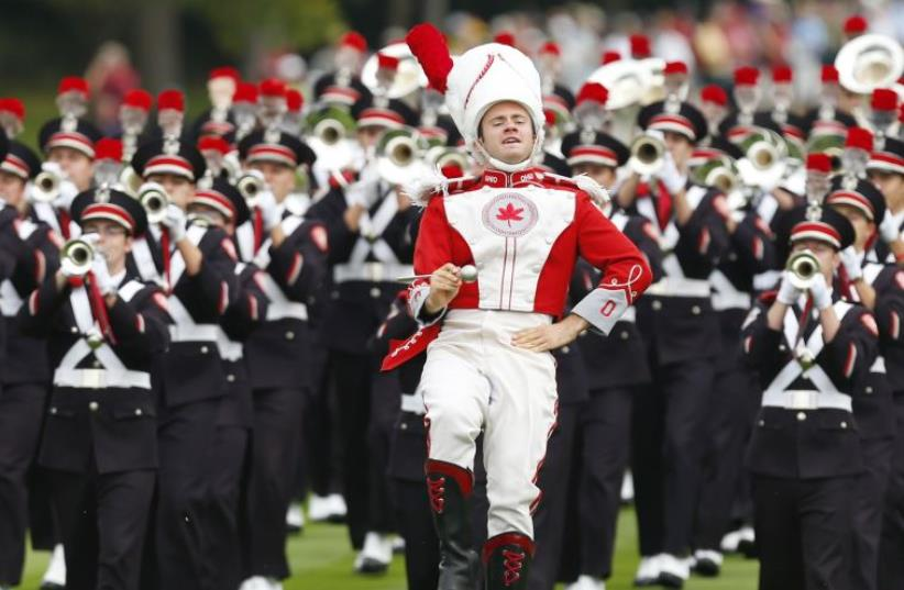 The drum major leads the Ohio State University marching band [file] (photo credit: REUTERS)