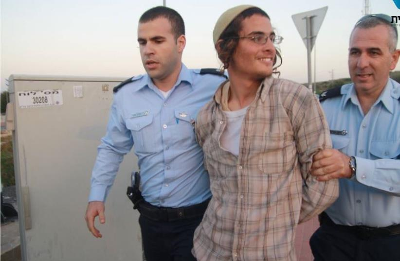 Police arrest Meir Ettinger (photo credit: TAZPIT)