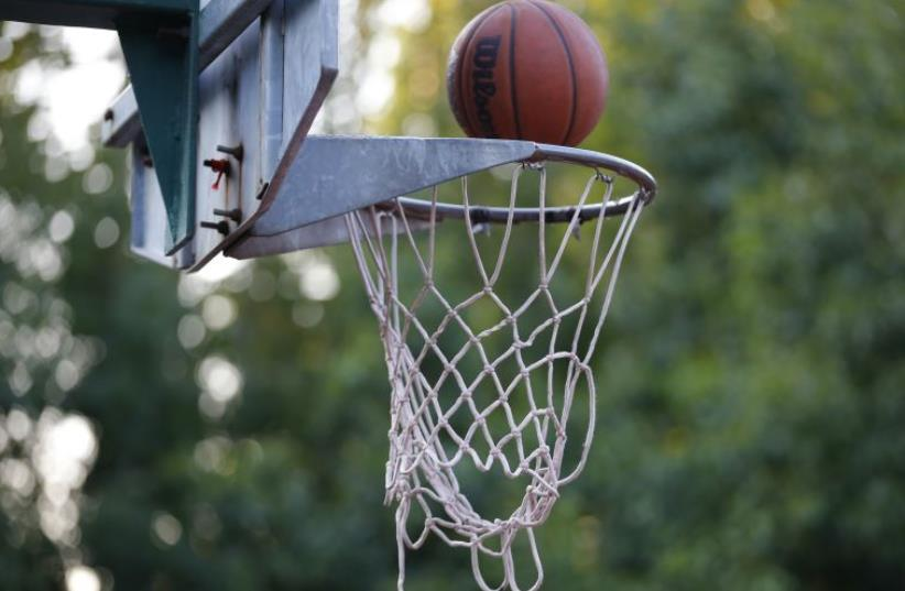basketball hoop (photo credit: REUTERS)