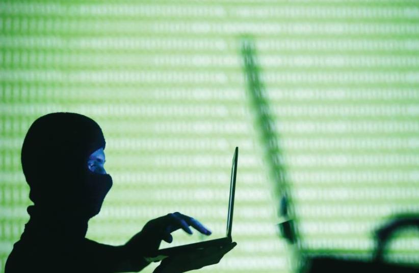 Computer hacking (illustrative) (photo credit: REUTERS)