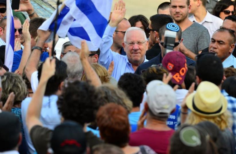 President Reuven Rivlin greeting supporters outside the President's Residence (photo credit: KOBI GIDON / GPO)