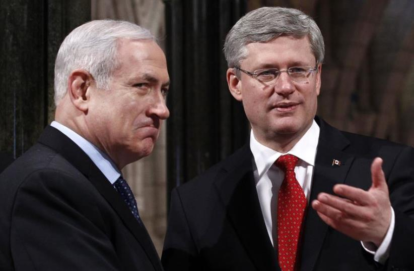 Canada's Prime Minister Stephen Harper (R) shakes hands with Prime Minister Benjamin Netanyahu in Ottawa (photo credit: REUTERS)
