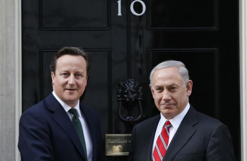 Britain's Prime Minister David Cameron (L) greets Prime Minister Benjamin Netanyahu at Number 10 Downing Street in London, April 17, 2013 (photo credit: REUTERS)