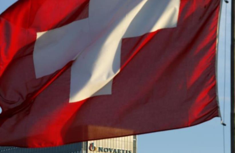 Swiss flag (photo credit: REUTERS)