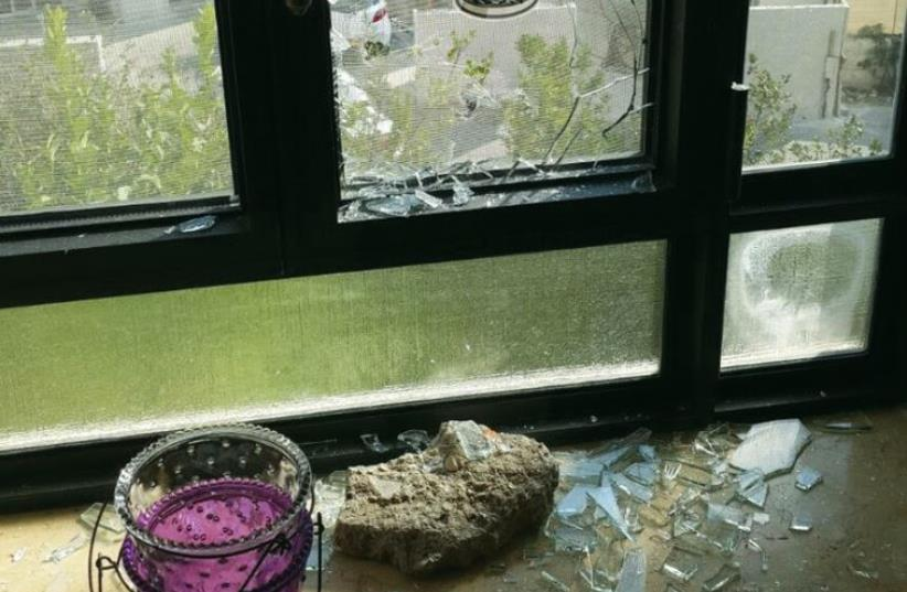 Rock-throwing shatters a window in an East Talpiot home. (photo credit: GIL SCHECHTER)