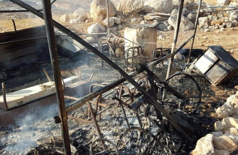Remains of burnt Beduin tent ‏ (photo credit: RABBIS FOR HUMAN RIGHTS‏)