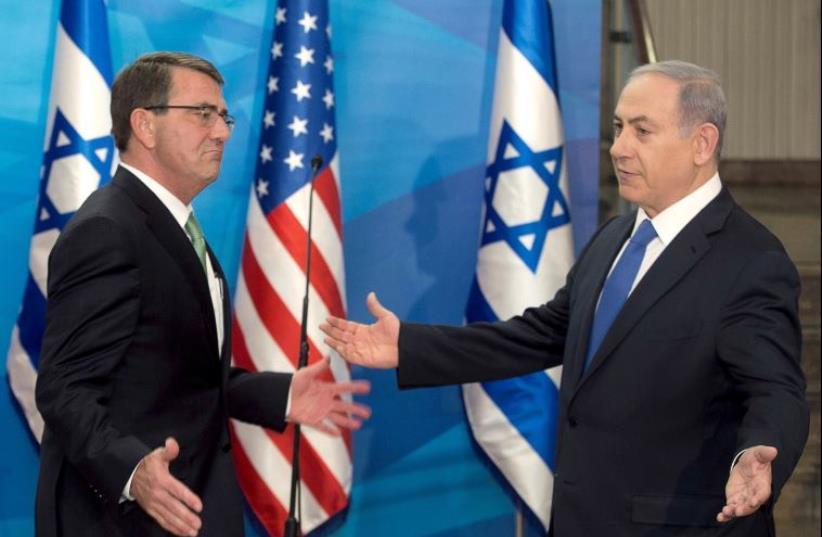 Benjamin Netanyahu greets visiting US Secretary of Defense Ashton Carter in Jerusalem, July 21 (photo credit: REUTERS)