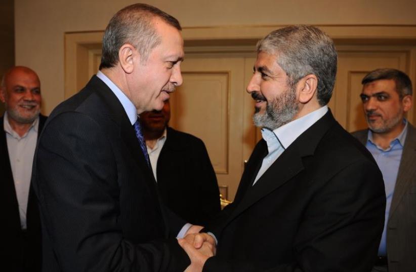 Turkey's Recep Tayyip Erdogan shakes hands with Hamas leader Khaled Mashaal [File] (photo credit: YASIN BULBUL / TURKISH PRIME MINISTER OFFICE / AFP)