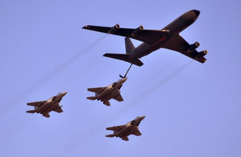 A Boeing 707 aerially refuels three F-15 Eagles (photo credit: YONATAN ZALK / IAF)