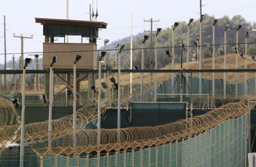 The exterior of Camp Delta is seen at the U.S. Naval Base at Guantanamo Bay, March 6, 2013. The facility is operated by the Joint Task Force Guantanamo and holds prisoners who have been captured in the war in Afghanistan and elsewhere since the September 11, 2001 attacks.  (photo credit: REUTERS)