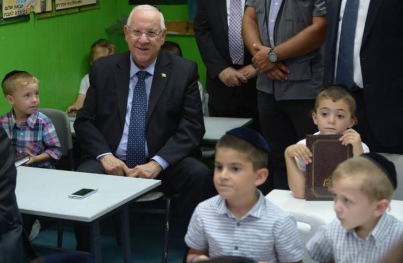 Rivlin at Haredi school in Jerusalem, August 16, 2015 (photo credit: AMOS BEN GERSHOM, GPO)