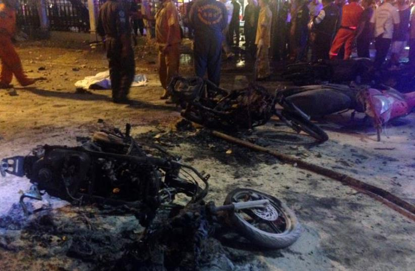 Destroyed motorbikes are pictured at the scene of devastation after a bomb exploded outside a religious shrine in central Bangkok late on August 17, 2015 (photo credit: AIDAN JONES / AFP)