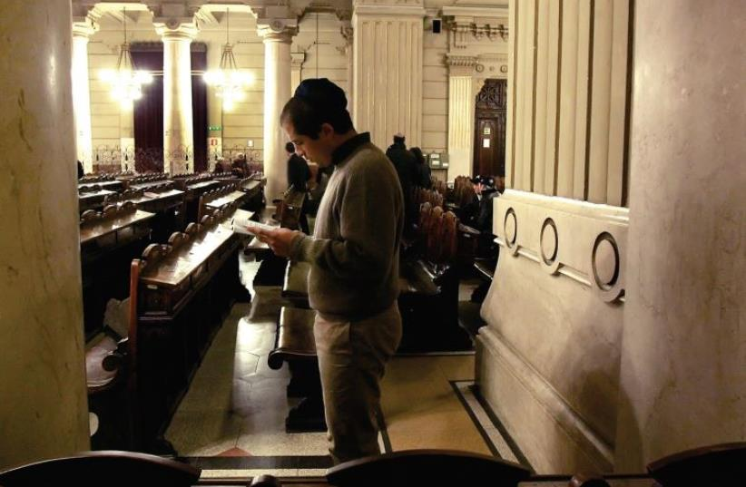A MAN prays in Rome's synagogue in 2006. Jewish demographics have many good tidings, the author argues. (photo credit: REUTERS)